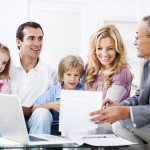 Young couple with children meeting with financial advisor.